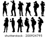 man and women with a camera on...   Shutterstock . vector #200924795
