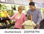 family shopping in supermarket | Shutterstock . vector #200958794
