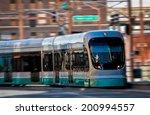 light rail train in motion  | Shutterstock . vector #200994557