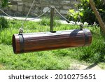 Small photo of A tool to get natural fat from milk. Wooden churn hanging to make butter . A back view picture of a wooden butter churn in a also used for making ayran . Nehra made of ancient wood.