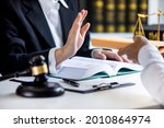 Small photo of Close-up view of a lawyer refusing graft from a client, make a deal agreement corruption, Judge gavel, brass scale, law firm office, dishonest, law and justice advice service.