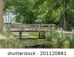 Small Wooden Bridge Over A Wid...