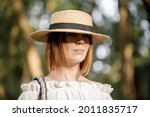 middle aged woman in a straw...   Shutterstock . vector #2011835717