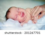 a cute newborn baby sleeping | Shutterstock . vector #201267701