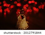 Small Statuette Of An Angel On...