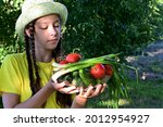 pretty girl in hat in garden...