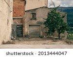 Derelict Brick House With Garage