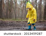Child In A Yellow Raincoat...