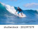 surfing a wave. lombok island.... | Shutterstock . vector #201397379