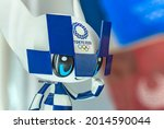Small photo of tokyo, japan - july 20 2021: Closeup on the face of a plastic figurine depicting the cute and kawaii official mascot character Miraitowa adorned with the Tokyo 2020 Olympic Games logo.