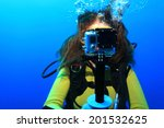scuba woman with action camera... | Shutterstock . vector #201532625