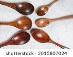 small spoons made of dark wood  ...   Shutterstock . vector #2015807024