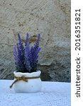White Vase With Lavander On...