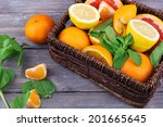 Fresh Citrus Fruits With Green...