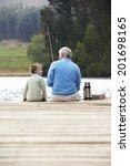 senior man fishing with grandson | Shutterstock . vector #201698165
