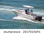 Small photo of Sport fishing boat powered by two outboard engines speeding on the Florid Intra-Coastal Waterway off of Miami Beach.
