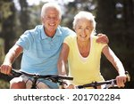 senior couple on bicycles | Shutterstock . vector #201702284