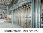Steel studs used to frame in a large commercial building. - stock photo