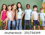 happy nursery teacher with her... | Shutterstock . vector #201736349