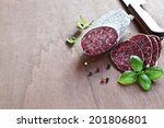 Cut Salami With Basil On Wood...