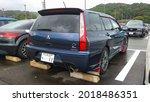Small photo of Blue Mitsubishi Lancer Evolution wagon parked on the stadium parking lot Shizuoka Japan September 8th 2018
