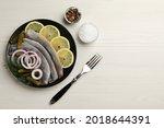 salted herring fillets served...