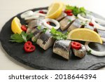 slate plate with sliced salted...