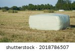 Several Large Square Bales Of...