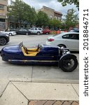 Small photo of LAWRENCE, UNITED STATES - Jul 10, 2021: A vertical shot of a Morgan three-wheeler classic car-motorcycle at the Mass Street in Lawrence, USA