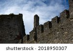 Defensive walls and towers of the castle against the cloudy sky. High quality photo