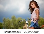 sexy woman with vintage bike in ...   Shutterstock . vector #201900004