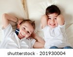two boys having fun in bed at... | Shutterstock . vector #201930004