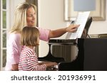 young girl playing piano in... | Shutterstock . vector #201936991