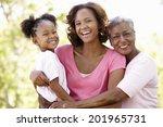 multi generation  family in park   Shutterstock . vector #201965731