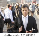 male commuter in crowd carrying ... | Shutterstock . vector #201988057