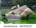 Wreckage of an American B-52 bomber in Huu Tiep Lake, Hanoi, Vietnam. Shot down by Vietnamese SAM during Operation Linebacker II in 1972. The wreckage is left where it crashed and now a War Memorial.
