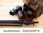 Photographer pack his camera and lenses to backpack. Bag appliances for photography.