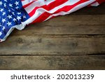 american flag on wood background | Shutterstock . vector #202013239