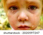 A Close Up Of A Sad Little Girl ...