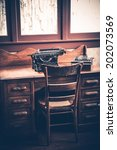 Small photo of Ghostwriter Desk. Vintage Desk with Aged Typewriter and Wooden Ghostwriter Chair.