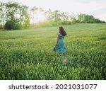 Happy Woman In Dress Running In ...