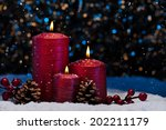 Three Red Candles In Snow With...