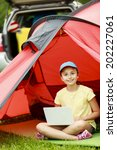 camp in the tent   young girl... | Shutterstock . vector #202227061