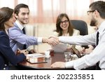 business group sealing a deal... | Shutterstock . vector #202235851