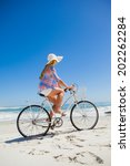 pretty blonde on a bike ride at ... | Shutterstock . vector #202262284