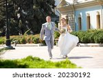 Groom and bride runinng - stock photo
