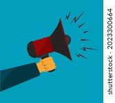 male hand holds red megaphone... | Shutterstock .eps vector #2023300664