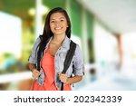 girl standing with her backpack ... | Shutterstock . vector #202342339