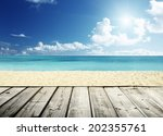 Tropical Beach And Wooden...