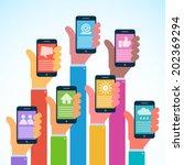 hands with modern smartphones   ...